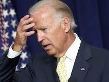 Biden hand to forehead