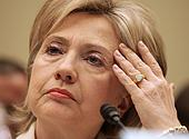 Hilary Clinto hand to forehead
